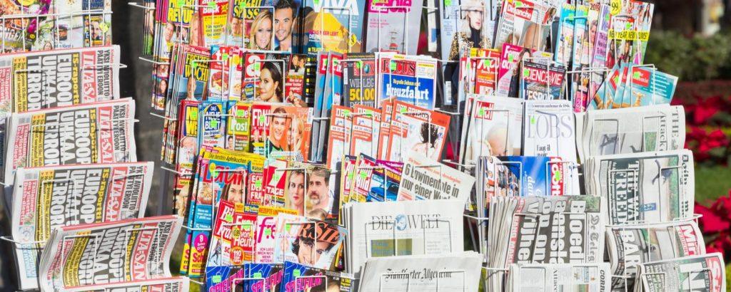EEAK65 International press stand at News kiosk in Spain