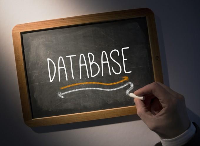 hand-writing-database-on-chalkboard