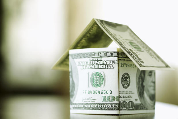 a house made from bills of 100 dollars, dof f/x, selective focus