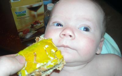 Even the little ones enjoy the King Cake! NOM NOM!